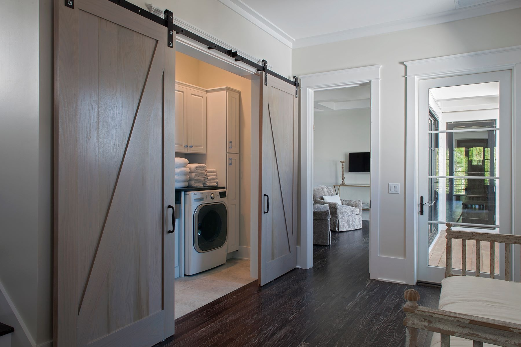 watercolor home 2nd floor barn doors to laundry room